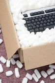 A Package Containing A Computer Keyboard — Stock Photo