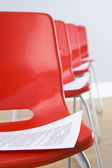 Row Of Chairs With Documents — Stock Photo