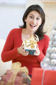 Woman Excited To Open Christmas Present — Stock Photo