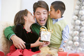 Father Being Given A Christmas Present By His Daughter And Son — Stock Photo
