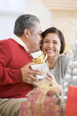 Middle Aged Couple Affectionately Sitting And Holding Christmas — Stock Photo