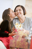 Granddaughter Kissing Grandmother On The Cheek,And Giving Her A — Stock Photo