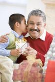 Boy Surprising Father With Christmas Present — Stock Photo