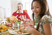 Grandfather And Granddaughter Sitting Down For Christmas Dinner — Stock Photo
