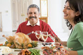 Father And His Adult Daughter Sitting Down For Christmas Dinner — Stockfoto