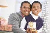 Father And Son Hugging,Holding Christmas Gift — Stock Photo
