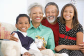 Children With Grandparents At Christmas — Stockfoto
