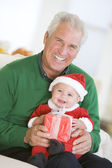 Grandfather With Baby In Santa Outfit — Stock Photo