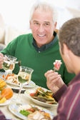 Father And Son At Christmas Dinner — Stock Photo