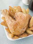 Portion Of Chicken And Chips On A Polystyrene Tray — Stock Photo