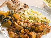 Chicken Bhoona, Sag Aloo, Pilau Rice And Naan Bread — Stock Photo