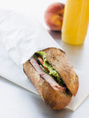 Ham And Salad Granary Baguette With Mango And Banana Smoothie An — Stock Photo