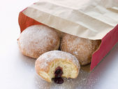 Bag Of Raspberry Jam Doughnuts With A Bite Taken — Stock Photo