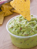 Pot Of Guacamole With A Corn Tortilla Crisp — Stock Photo