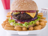 Cheese Burger In A Sesame Seed Bun With Fries — Stock Photo