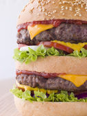 Double Cheese Burger In A Sesame Seed Bun — Stock Photo