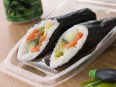 Hand Moulded Sushi With A Can Of Green Tea — Stock Photo