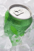Green Can Of Fizzy Soft Drink Set In Ice — Stock Photo