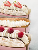 Creamed Meringue And Chocolate Eclair — Stock Photo