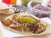 Marinated Chicken Kebab In A Pitta Bread With Salad And A Pickle — Stock Photo