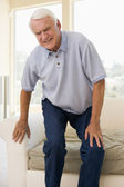 Senior Man Trying To Sit Down — Stock Photo