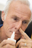 Senior Man Using Nasal Spray — Stock Photo