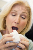Senior Woman Sneezing — Stock Photo