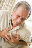 Man Clutching His Heart — Stock Photo