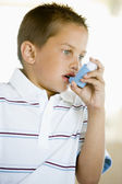 Boy Using An Inhaler — Stock Photo