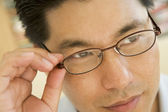 Man Looking Through New Glasses — Stock Photo