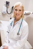 Middle Aged Female Doctor Sitting In A Hospital Ward — Stock Photo