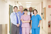 Hospital Team Standing In A Corridor — Stock fotografie