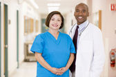 A Doctor And Nurse Standing In A Hospital Corridor — Stock Photo
