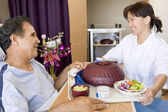 Nurse Serving A Patient A Meal In His Bed — Stock Photo