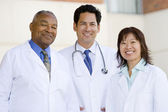 Three Doctors Standing Outside A Hospital — Stock Photo