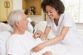 Nurse Helping Senior Man — Stock Photo