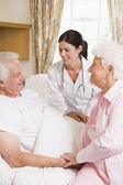 Doctor Talking To Senior Man And His Wife — Fotografia Stock