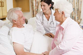 Doctor Talking To Senior Couple — Stock Photo