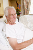 Senior Man Sitting In Hospital Bed — Stock Photo