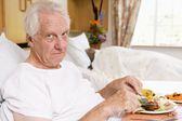 Senior Man Eating Hospital Food In Bed — Stock Photo
