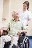Nurse Pushing Man In Wheelchair — Stock Photo