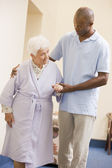 Nurse Helping Senior Woman To Walk — Stock Photo