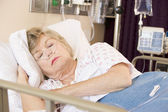 Senior Woman Sleeping In Hospital Bed — Stock Photo