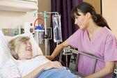 Nurse Talking To Senior Woman — Stock Photo