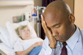 Doctor Looking Tired And Frustrated In Hospital Room — Stock Photo