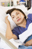 Senior Woman Lying Down In Hospital Bed — Stock Photo
