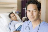 Doctor Standing In Patients Room — Stock Photo