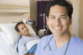 Doctor Smiling In Patients Room — Stock Photo