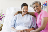 Mother And Daughter Smiling In Hospital — Stock Photo