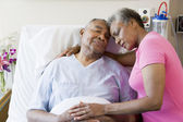 Senior Couple Embracing In Hospital — Stock Photo